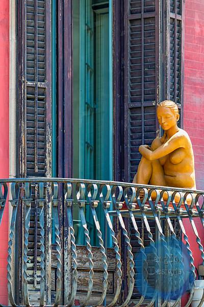 Women Resting on a Balcony Statue