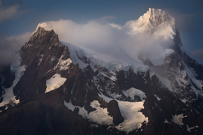 Chile, Patagonia: The tallest peak in the range at Torres del Paine National Park, Cerro Paines Grande Peak is rarely seen without clouds.