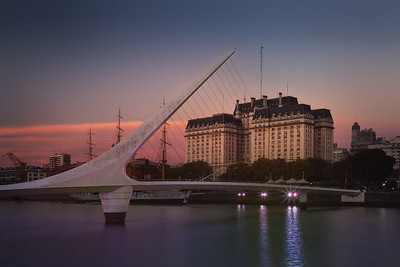 Argentina, Buenos Aires: El Puente de la Mujer, the Woman's Bridge, is one of the most iconic landmarks in Buenos Aires. It was designed by the famous architect Santiago Calatrava, who also built the famed City of Arts and Sciences in Valencia, Spain (his birthplace). Being the first of only two structures by this architect in Latin America, he described this bridge as an image of a couple dancing the tango.