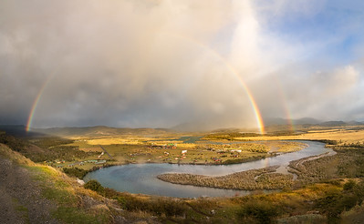 Chile, Patagonia: A rainbow shines over Rio Serrano in the Serrano Valley at Torres del Paine National Park.