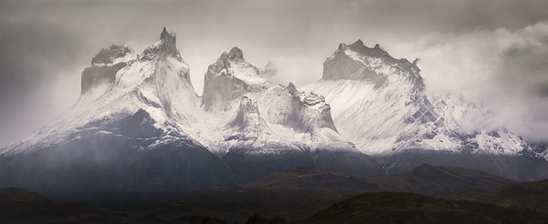 Chile, Patagonia; Snow covers the peaks of the mountains in the early morning in Torres del Paine.