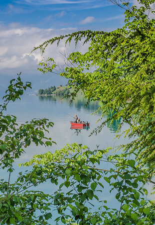 Fishing in the emerald-colored waters of lake Brienz, Interlaken