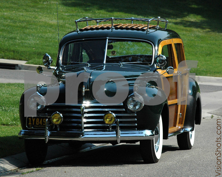 "1941 Chrysler Town and Country - This magnificent automobile is one of the few remaining out of the 797 originally built by Chrysler. The solid ash and mahagony trim are classic features of this pre-war ""woody wagon"". After World War II, only convertibles, sedans and hardtops were manufactured instead of the wagon. This photo was captured at Lake Sherwood, California."