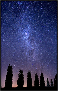 Southern Cross Sky.  In Hunter Valley, NSW, Australia, a wine country area, i saw a sky that was all lit up with stars.  I can't remember ever seeing so many stars.   I over exposed this image so you see even more stars that what i could see but the Milky Way was spectacular here.  In this photo is the Southern Cross.  Difficult to see in this photo but i had heard about it and expected it to be a lot larger constellation than it was.  A beautiful night in Australia.