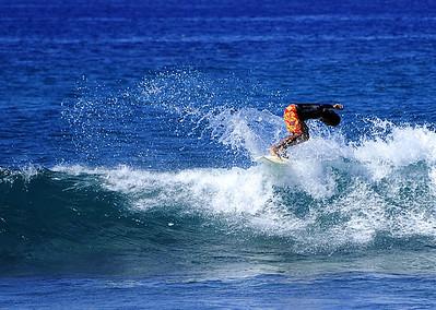 Surfer at Poipu Beach