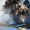 The sun bursts through the steam, Mammoth Hot Springs