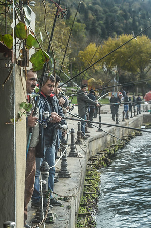 Fishermen are fishing on the banks of the Bosphorus, Istanbul