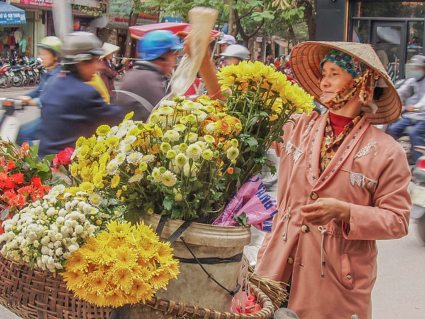 Flower seller in the streets of Hanoi