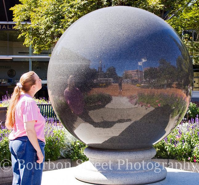 Gazing Into a World Reflected - (9.5 ton polished granite sphere in Quincy Center, MA)