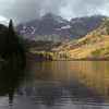 An autumn thunderstorm rolls in over Maroon Bells from Maroon Lake in the Colorado Rockies