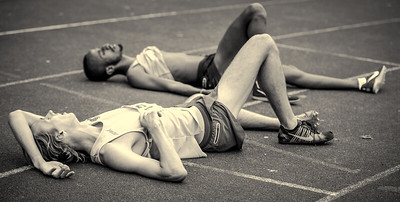 Exhausted runners collapse on the track at the Hercules Wimbledon 3000 metre festival.