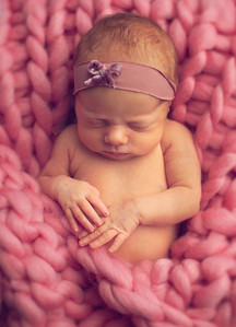 baby girl in pink photographed by newborn photographer highbury