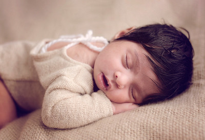 Sleepy newborn baby girl photographed by newborn photographer highbury