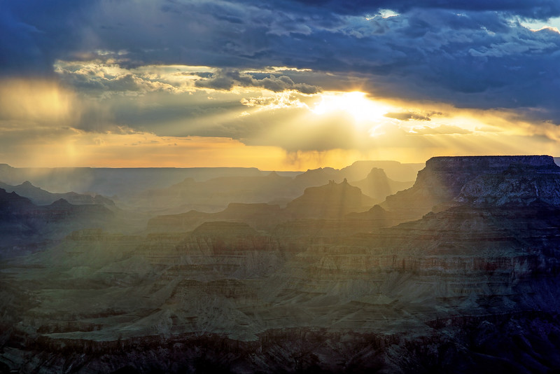 Grand Canyon - Arizona.  A great view of the Grand Canyon during a hazy cloudy sunset.  I arrived with just enough time to setup the camera as the sun made an appearance from behind the clouds.