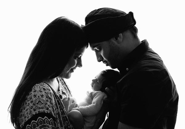 family with new baby photographed by newborn photographer highbury