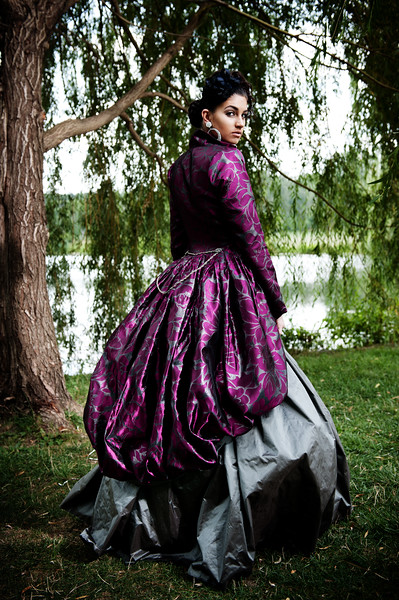Nikki wears Sofistafunk. Sofistafunk, The Original Skirt Company, is a design house based in Verona, NJ, owned by designer Arlinda McIntosh. Sofistafunk is known for its unique collection of 'bottom frocks' (skirts) for women and children. Sofistafunk's designs are influenced by women's fashions of the Victorian era of the 19th century, particularly women's gowns with narrow sloping shoulders, low pointed waists, and bell-shaped skirts. Photo by Brandon Vick https://www.brandonvickphotography.com/