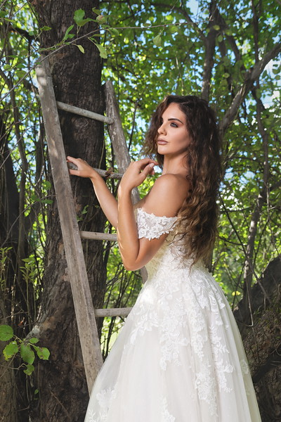 """Stella wears a Justin Alexander ball gown at Stella's Bridal Boutique in Le Roy, NY. Photo by Brandon Vick, <a href=""""https://www.brandonvickphotography.com/"""">https://www.brandonvickphotography.com/</a>"""