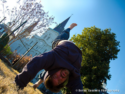 Pashupa doing urdvha dhanurasana (wheel pose) with the St Louis Cathedral in New Orleans  in the background.