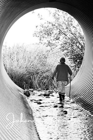 Boy inside a pipe
