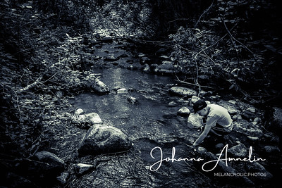 Boy is looking for treasures from the river which the story tells stained red from blood of soldiers hundreds of years ago