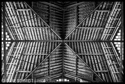 One of the most interesting buildings in Vermont is the Breeding Barn at Shelburne Farms.  It is off the main property and requires either local knowledge or luck to find it.  It is one of the largest wooden structures in the northeast.  It is generally open if you walk in.  The floor is dirt but the ceiling is this intricate maze of wood.  Go to the north end and look straight up and this is what you will see.  You will also see this if you happen to be in the right hotel in Taipei, Taiwan where they have printed this as a mural and put it on the ceiling of several quest rooms.  Shelburne, Vermont. February, 2008.    http://www.shelburnefarms.org/