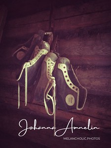 Ice skates hanging from a wall in an abandoned house