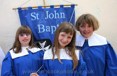Three girls with banner a