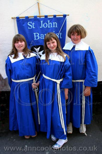 Three girls with banner