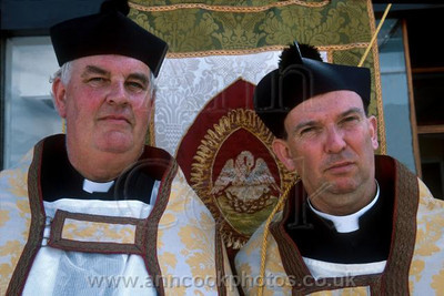 Two serious priests