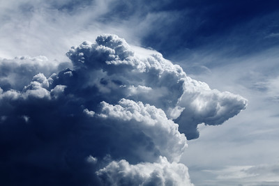 Cumulonimbus On Blue Sky