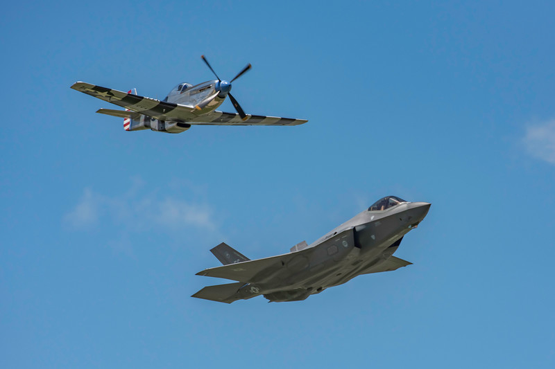 """America's newest fighter, the Lockheed Martin F-35 Lightning II, performing in the feature show as a a Heritage Flight with the P-51 Mustang for the first time ever! The Lightning II is a 5th generation fighter that combines advanced stealth with fighter speed and agility. Three distinct variants of the F-35 will be flown by the U.S. Air Force, the U.S. Navy and the U.S. Marine Corps. The F-35A is flown by the U.S. Air Force. The F-35 will travel to Dayton from the 56th Fighter Squadron at Luke AFB, Arizona. It is flown by Major Will """"D-Rail"""" Andreotta."""