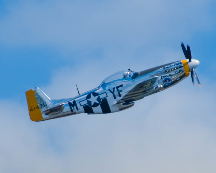 """P-51 D """"Dakota Kid"""" performs for the crowd at the 2013 Wings Over Houston Airshow, on October 26-27, 2013."""