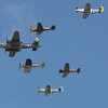 "Warbirds from the Texas Flying Legends Museum aligned in the Missing Man Formation, pay tribute to ""The Galveston Gal"", a P-51 lost just days before, at the Wings Over Houston Airshow, on October 26-27, 2013.<br /> <br /> Image 3 of 3"