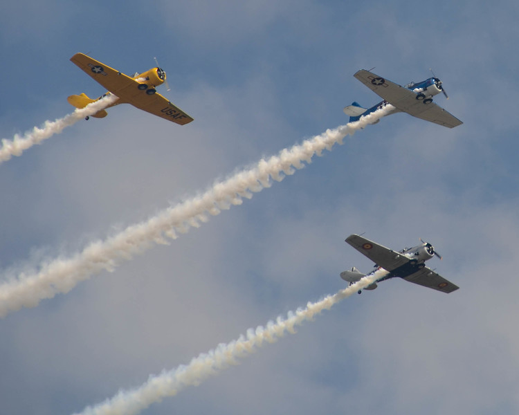 American aircraft take to the air in response to the Japanese attack on Pearl Harbor, reenacted at the Wings Over Houston Airshow, on October 26-27, 2013.