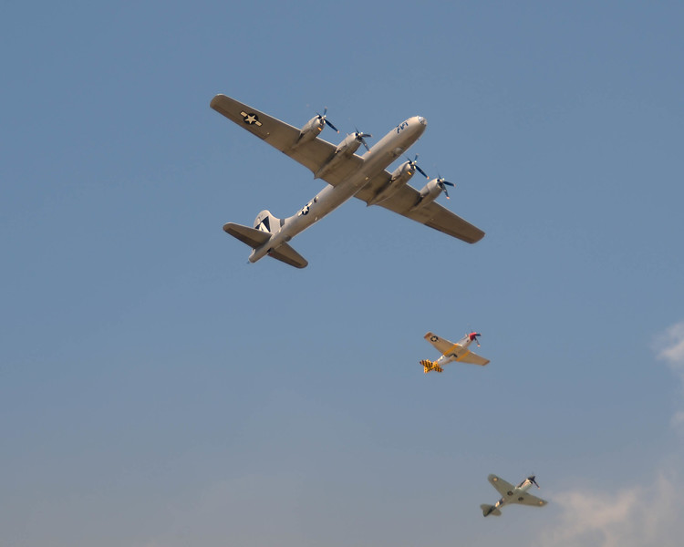 """The world's last remaining, airworthy, B-29, """"Fifi"""" being escorted by P-51 Mustangs during the 2013 Wings Over Houston Airshow, on October 26-27, 2013.<br /> <br /> Image 3 of 3"""