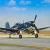 Grumman F4U Corsair taxis to the active runway at the 2013 Wings Over Houston Airshow, held on October 26-27, 2013.