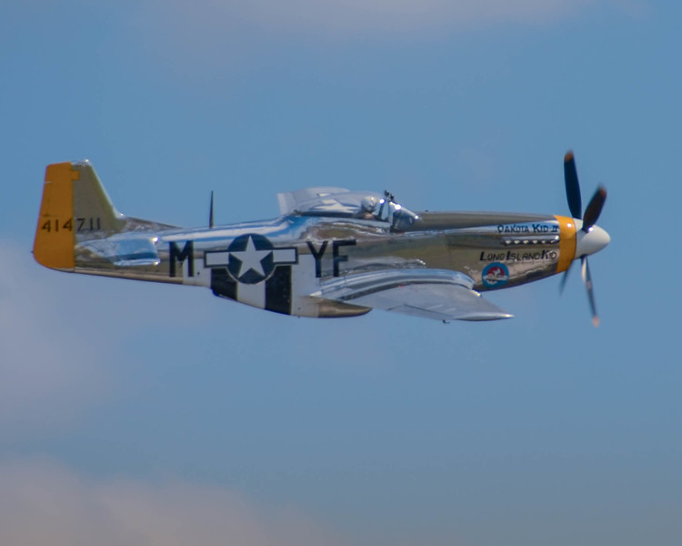 "P-51 D ""Dakota Kid"" performs for the crowd at the 2013 Wings Over Houston Airshow, on October 26-27, 2013.<br /> <br /> Image 1 of 2"
