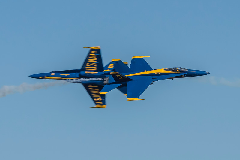 """Another often sought after capture by photographers of the US Navy Opposing Solos #5 and #6 as they perform a """"knife edge"""" high speed pass, at the Wings Over Houston Air Show, November 2014."""