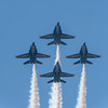 US Navy Blue Angels diamond formation screams overhead at the Wings Over Houston Air Show, November 2014.