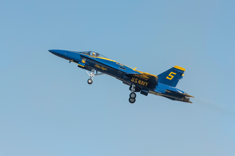 US Navy Blue Angels Opposing Solo #5 performs low speed maneuvers, showing off the versatility of the F/A-18, at the Wings Over Houston Air Show, November 2014.  Image 1 of 3