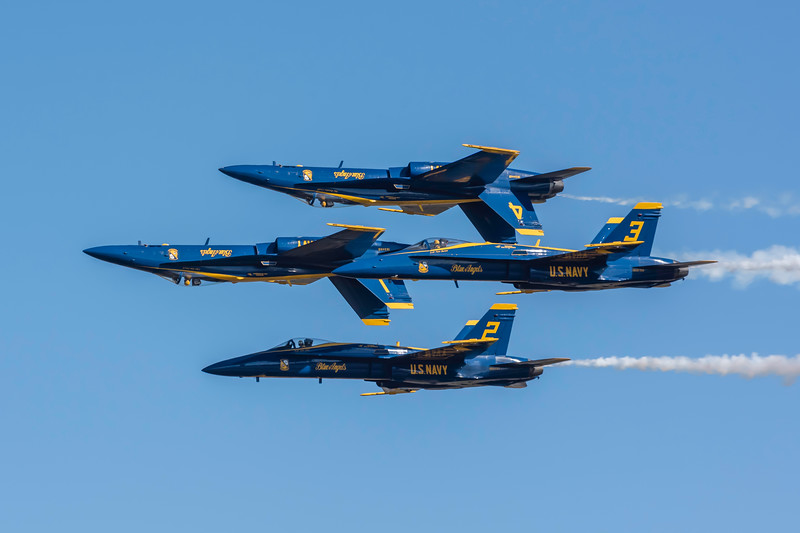 """US Navy Blue Angels """" 2 Up"""" and 2 """"Down"""" pass in front of the crowd at the Wings Over Houston Air Show, November 2014."""