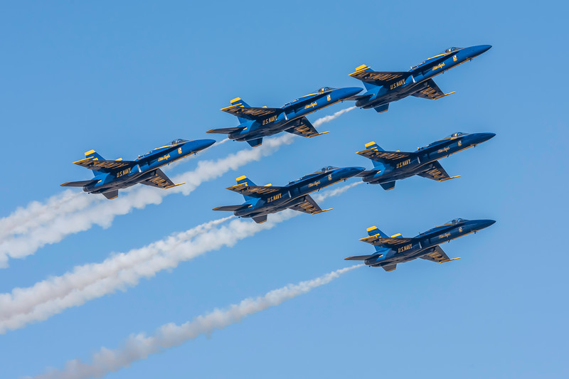 US Navy Blue Angels Flight Demonstration team final salute the the crowd and pass in review at the Wings Over Houston Air Show, November 2014.