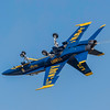 US Navy Blue Angels Opposing Solo #5 performs low speed maneuvers, showing off the versatility of the F/A-18, at the Wings Over Houston Air Show, November 2014.  Image 3 of 3