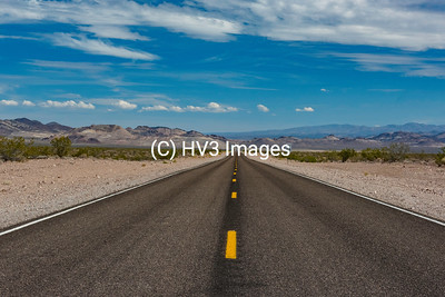 "December Feature Image:  ""The Long Road"".  On a clear day such as when this image was captured, you can see for many miles.  Outskirts of Death Valley, somewhere in Nevada, on the approach to the area formally known as ""Area 51""."