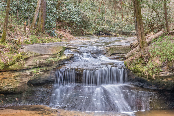 Stanton, KY.  Creation Falls; Red River Gorge National Geographical Area.  This intricate canyon system features an abundance of high sandstone cliffs, rock shelters, waterfalls, and natural bridges.  There are more than 100 natural sandstone arches in the Red River Gorge Geological Area.