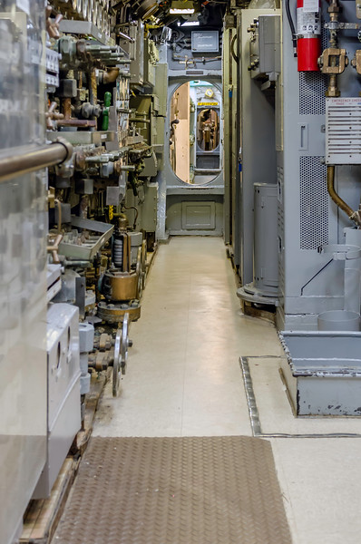 One of the many passageways below decks.  This image provides a great perspective of how much attention is given to make use of every available inch!