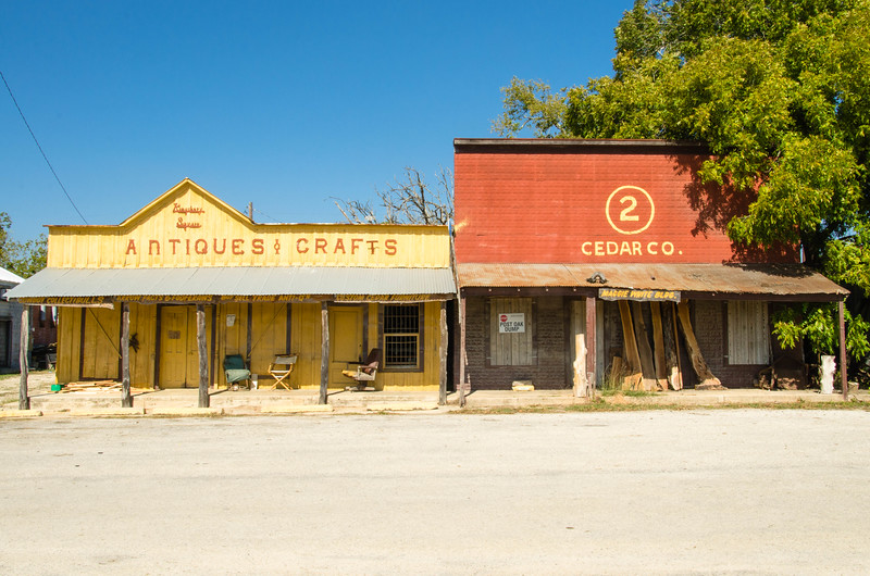 On another lonely, abandoned street in Kingsbury, Texas; stand the antique and craft store and the local hardware store in Kingsbury, Texas