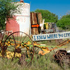 One of many interesting signs found on a farm along a rural road just outside the ghost town of Kingsbury, Texas