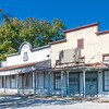 Abandoned store fronts stand silently in the abandoned ghost town of Kingsbury, Texas