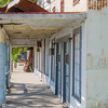 The hot summer Texas sun casts some shade on storefronts abandoned many years ago in the ghost town of Kingsbury, Texas